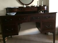 Vintage dark wood dressing table with 7 drawers. Mirror also available to hang above.