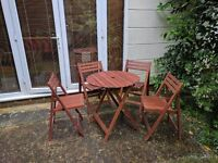 Outdoor wooden folding table and chairs - perfect for summer BBQs!