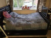 Black leather tv bed