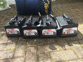 4 plastic petrol cans with nozzles