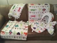 Nursery bedding set with matching Moses basket cover.