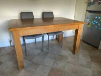Dining table and four chairs, with extending section. In great condition.