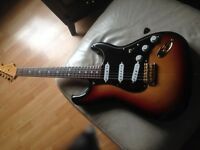 Stevie Ray Vaughn signature Fender Stratocaster . very good condition , £1000