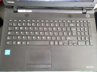 thin toshiba 15.6in screen laptop intel X2 core 4gb ram 1tb dvd scratched lid but inside perfect!