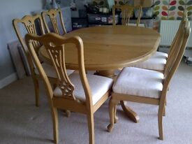 Solid wood immaculate handcrafted extendable dining table and 6 chairs