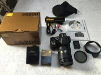 Nikon D5200 with Nikon 18-200mm lens plus extras