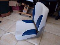 Boat seat. Brand new / unused. Folds flat suit speedboat or cruiser
