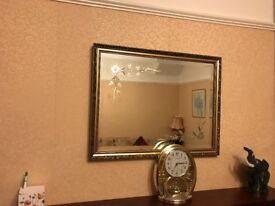 Gold look framed mirror