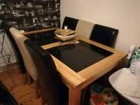 Solid wood side board and table with black glass
