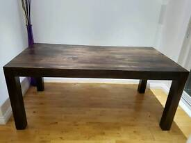 6 seater wooden dining table.