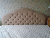 double bed with mattress and head board