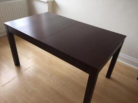 Used IKEA 'bjursta' extendable table in black brown