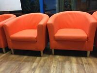 Orange Faux Leather Tub Chairs.