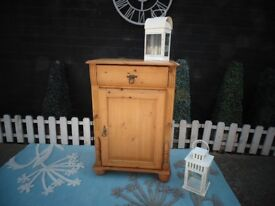 SOLID PINE TALL CABINET WITH 1 DRAW AND 1 DOOR VERY SOLID UNIT AND IN EXCELLENT CONDITION
