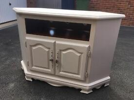 Ivory restored TV stand with distressed finish.