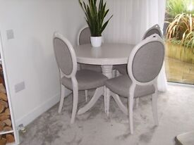 Round dining table and 4 upholstered chairs