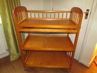 PINE BABY CHANGING UNIT ON WHEELS WITH SHELVES AND BATH SPACE LOVELY ITEM LOOKS GREAT!!