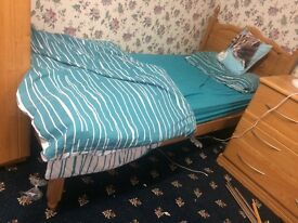 Wooden single bed with mattress and frame