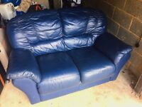 Two seated faux leather sofa