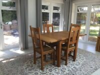 Extendable oak dining table with 4 chairs