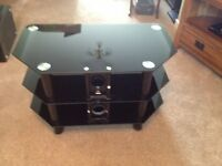 T.V. table black heavy toughend glass