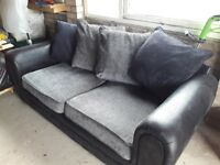 Large 2 seater sofa in black & grey, approx 3 years old and in excellent condition, hardly used.