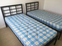 2 single beds and mattresses. Both in very good condition.