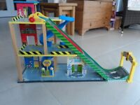 Child's toy -Sturdy wooden garage with ramp and accessories