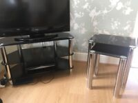 Lovely black glass TV stand and matching nest of tables