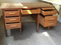 Solid Wood Office Desk with six drawers with writing pad.