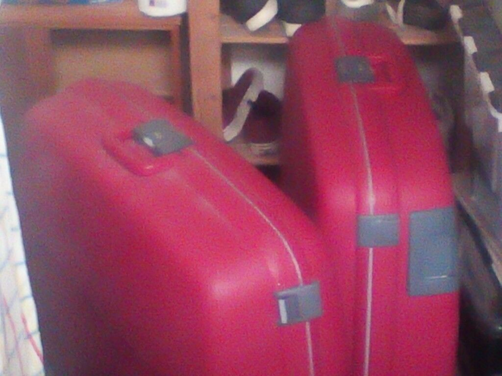 Two red suit cases