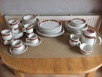 53 pieces plus tea pot sugar bowl and milk jug.