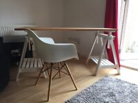 Eames style chair with height adjustable desk.