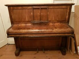 Piano free to collector. Needs work and tuning