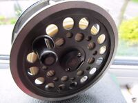 J W Young salmon reel with 3 spare spools