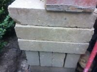 Approx 25 concrete breeze blocks