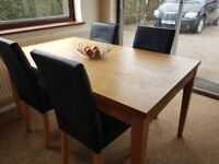 Dining wood table and black chairs