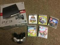 PS3 320gb with 6 games 2 wireless controllers and docking station