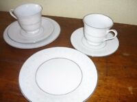 whits china teaset with faint pattern