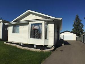 Single family home in Springbrook with garage and fenced yard