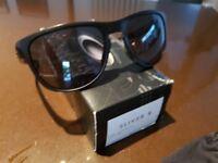 Oakley Sliver R Matte black with grey lens.