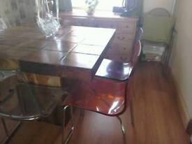 Four perspex chairs
