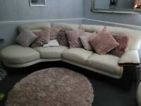 white leather and black corner sofa with swivel chair