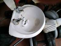 Sink with pedestal and disabled taps
