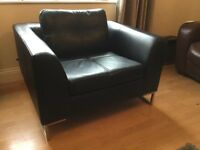 DFS Dwell black leather arm chair