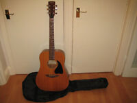 Stella 6 string acoustic guitar with gig bag