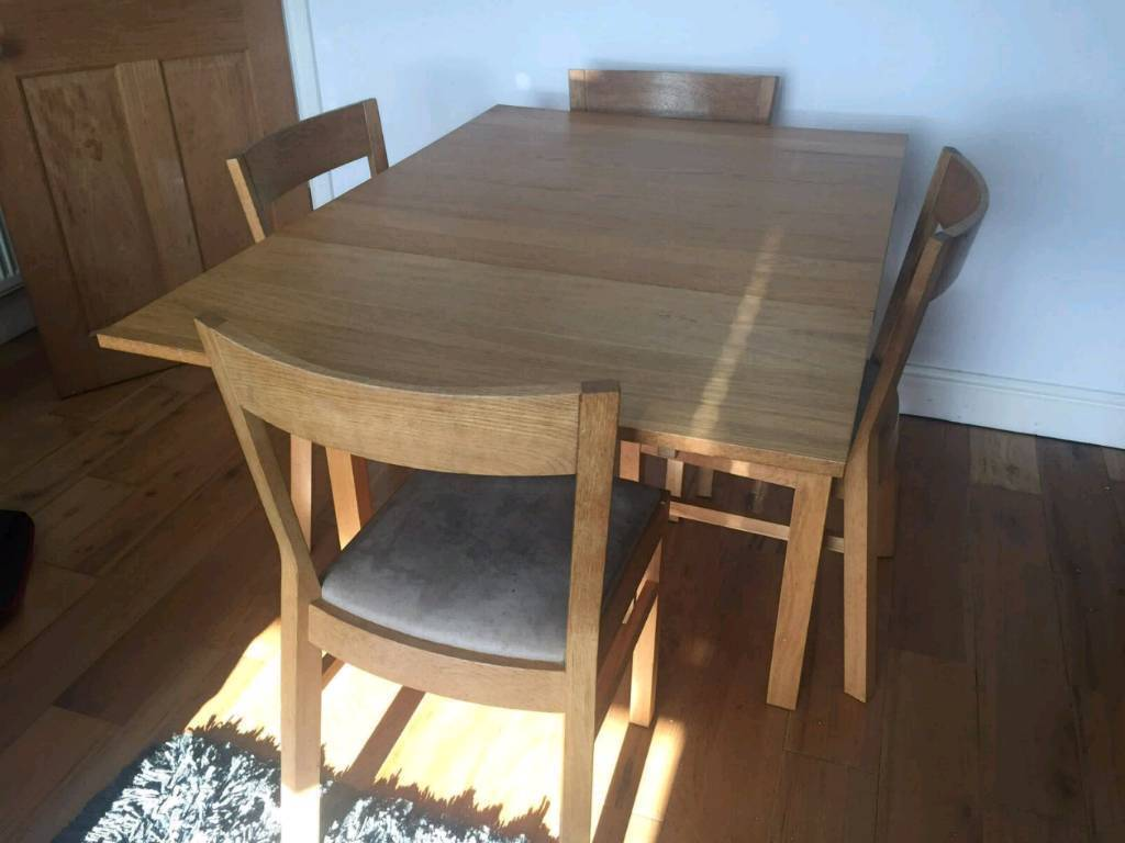 Ikea bjursta extending dining table and four solid oak for Four chair dining table