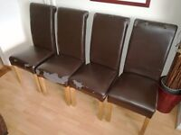 4 used faux leather chocolate brown dining chairs