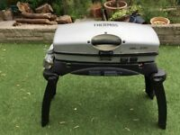 Thermos Grill 2 Go barbeque with folding legs.