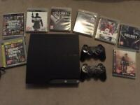 PlayStation 3 with 8 classic games and 2 controllers